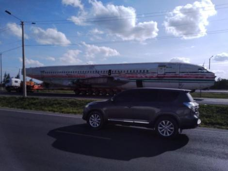 An airplane's fuselage being transported at a highway in Kenya.