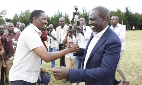Former Agriculture CS Mwangi Kiunjuri (l) enjoy a hearty moment at Thiru Secondary School, Laikipia West, Laikipia County on February 22, 2020.