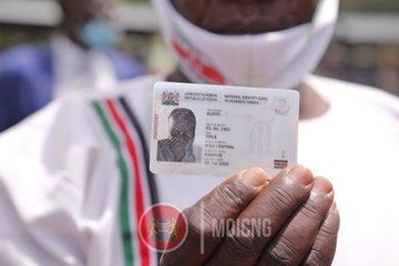A person holding the new Huduma Namba Card unveiled on Tuesday, October 20, 2020.