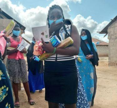 Milka and Red Cross teams receive donations from Hon. Mwanajuma Mabuke
