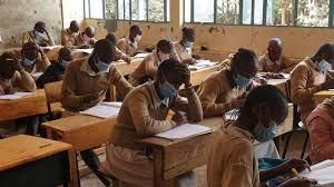 Students during a lesson in class wearing masks