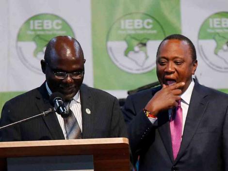 IEBC chairman Wafula Chebukati and President Uhuru Kenyatta at the IEBC National Tallying Centre at the Bomas of Kenya, Nairobi, August 11, 2017, when Uhuru was announced winner of the presidential election.jpg