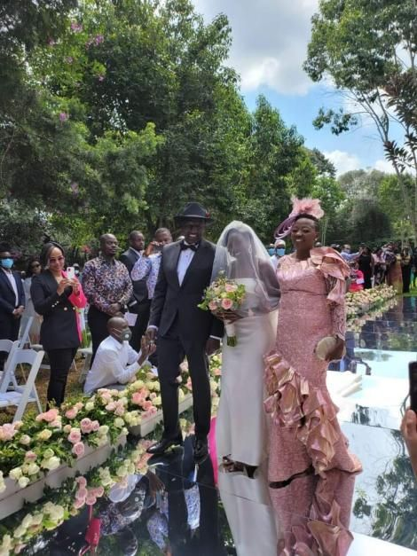 June Ruto walks down the aisle accompanied by her parents DP William Ruto and Rachel Ruto on Thursday, May 27.