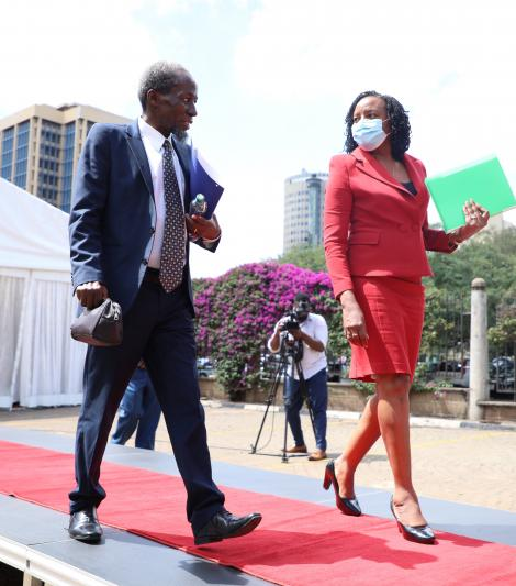 Justice Marete Njagi being escorted by the Secretary to the JSC, Anne Amadi, at the conclusion of his interview before the JSC Panel
