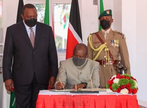 President Uhuru Kenyatta (standing) and President of The Republic of Burundi Evariste Ndayishimiye in Kisumu on May 31, 2021.