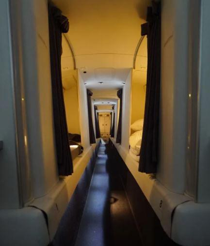 A door leading to the sleeping area where the cabin crew take a break.