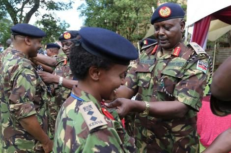 Army Commander Lt General Robert Kibochi elevating an officer to Colonel rank.
