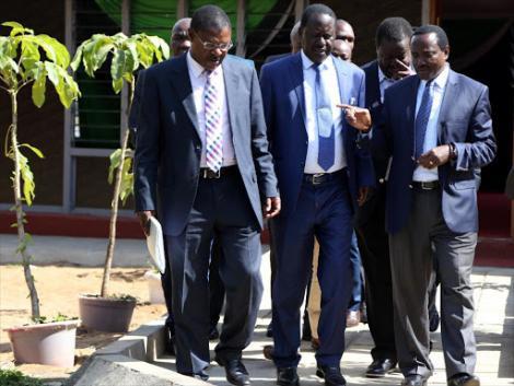 From left: NASA co-principals Moses Wetangula, Raila Odinga, Musalia Mudavadi and Kalonzo Musyoka discuss prior to a press conference in 2017