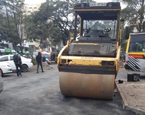 A road construction machine in the Central Business District on July 8, 2021