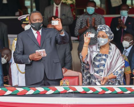 President Uhuru Kenyatta and First Lady Margaret display new Huduma Cards at Gusii Stadium on Tuesday, October 20, 2020.
