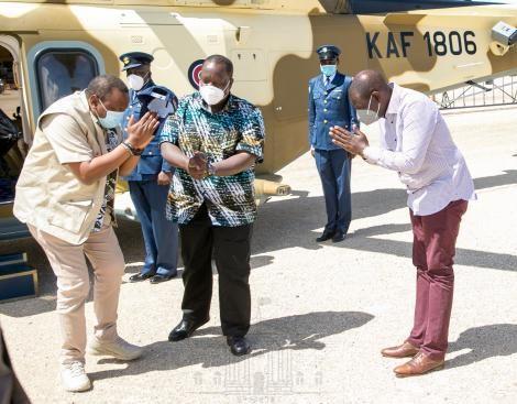 President Uhuru Kenyatta greets Deputy President William Ruto on arrival at the KWS Law Enforcement Academy in Manyani, Taita Taveta County on October 16, 2020