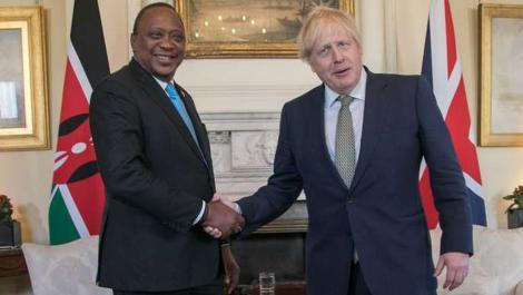 A file image of President Uhuru Kenyatta (left) and British Prime Minister Borris Johnson.