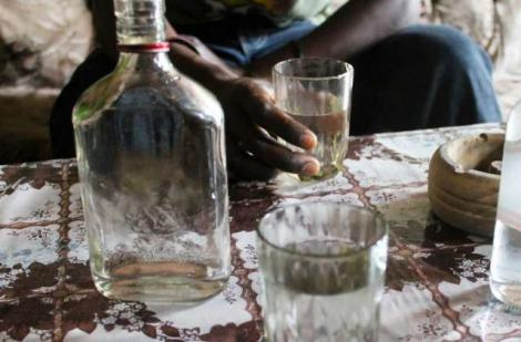 Undated image of a man drinking illicit liquor