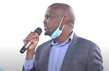 Gatundu South MP Moses Kuria speaking during the burial of musician Mighty Salim in Nakuru County