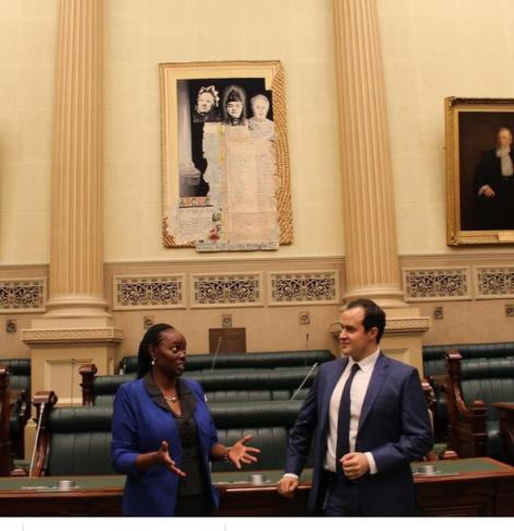 Lucy Gichuhi, Australia's first black African born Member of Parliament posing with a colleague