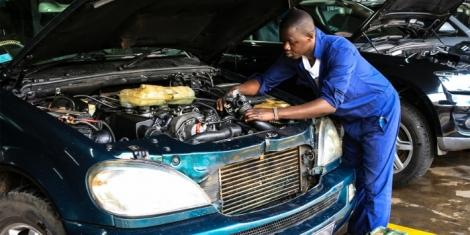 A mechanic working on a car at a garage