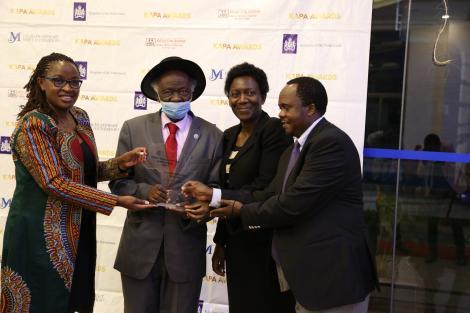 Senior Counsel John Khaminwa receiving his award from Kituo Cha Sheria officials.