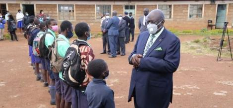 Education CS George Magoha conversing with 2020 KCPE Candidates