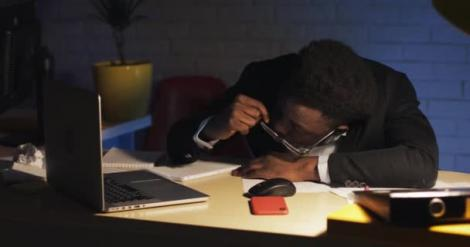 File image of a man sleeping in an office