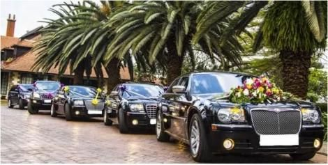 A convoy of vehicles at a wedding