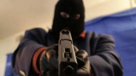 A gunman in a balaclava