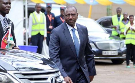 Deputy President William Ruto walking past his vehicle