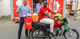 Coca-Cola Beverages Africa, Sales and Marketing Director, Josphat Mwangi (left) with Franchise Director, Kenya and Tanzania, Oliver Soto (centre) and Kevin Abunyolo a deliveries rider pose for a photo during the launch.