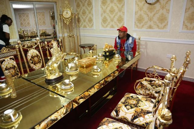 Nairobi Governor Mike Sonko overlooks a set-up table made of golden sculptures on Sunday, December 1, 2019.