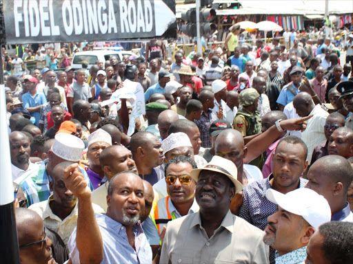 Mombasa Governor Hassan Joho, Cord leader Raila Odinga and Mvita MP Abdulswamad Nassir during the official opening of Fidel Odinga Road