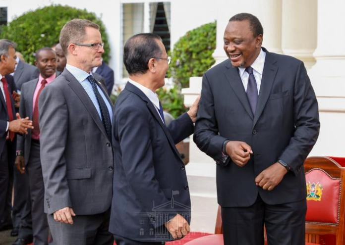 President Uhuru Kenyatta enjoying a laugh with delegates outside State House Nairobi on March 3, 2020.