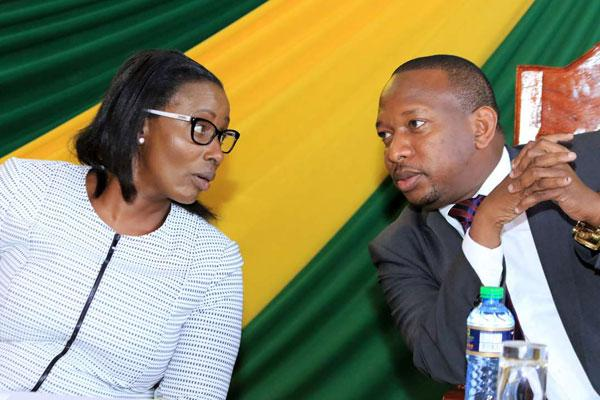 Nairobi Speaker Beatrice Elachi(Left) has a word with Governor Mike Sonko(Right) during the swearing-in of county executive committee members at Charter Hall on November 10, 2017.