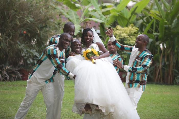 Boniface Mwangi (far right) poses for a photo with the groomsmen during Miriam Ayoo and Sam Soko's wedding on August 12, 2019.