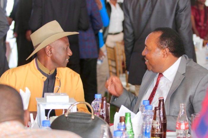 Deputy President William Ruto and former Kiambu governor Ferdinand Waititu during Waititu's daughter wedding in Kiambu in July 2019
