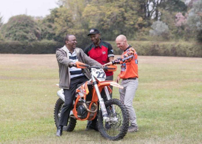 President Uhuru Kenyatta on a motorbike at State House on August 23, 2019.