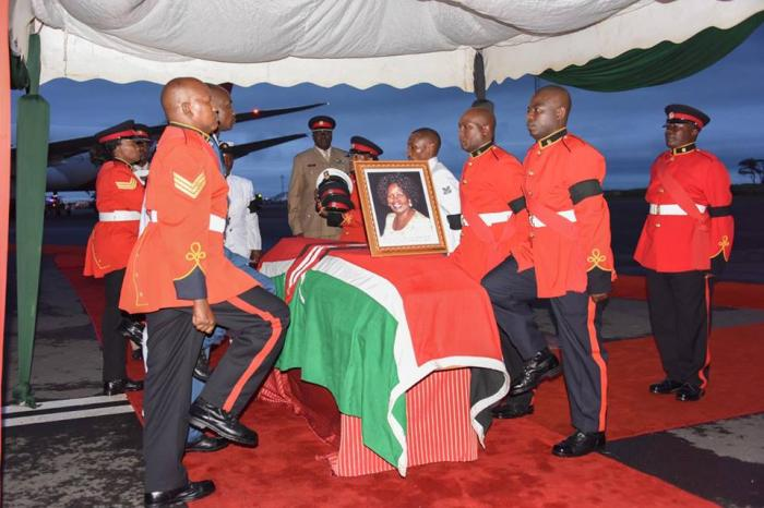 Soldiers conducting rites next to Mama Lucy Kibaki's body during her funeral ceremony.