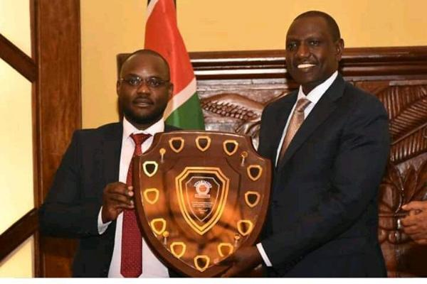 DP Ruto being feted with East by the founder of the award Paul Bamutaze on Tuesday..