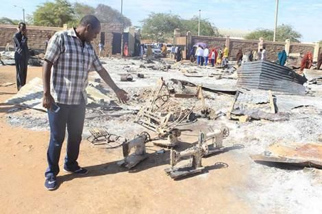 A man shows his sewing machines which were destroyed in a fire at the Mandera miraa market on January 8, 2019.