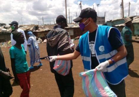 A social worker distributing face masks in Nairobi.