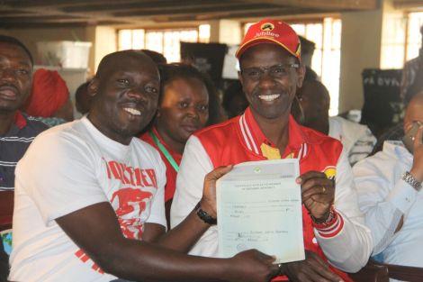 Ruiru MP Ng'ang'a King'ara(Right) issues election certificate to deceased Kahawa Wendani MCA Cyrus Omondi