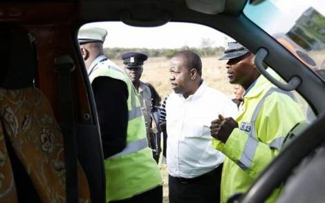 Interior CS Fred Matiang'i interacts with Police officers during a past traffic crackdown