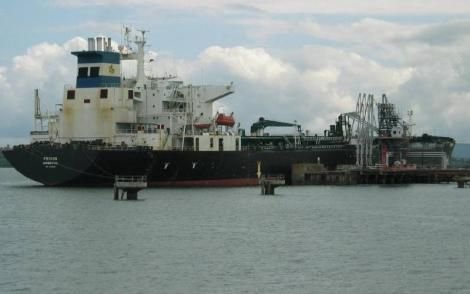 An oil tanker, Mt Frixos, discharges crude oil at Kipevu terminal at the port of Mombasa