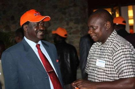 ODM Party Leader Raila Odinga with ODM Communication Director Philip Etale. Photo undated.