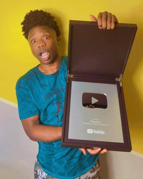 Comedia Flaqo showing off his YouTube Silver Button Award