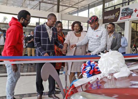 Michael Njogo Gitonga, President Uhuru Kenyatta's lookalike, receives a brand new vehicle on Friday, September 4