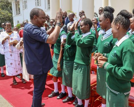President Uhuru Kenyatta interacts with students of Nyiro Girls' Secondary School, Samburu County at State House, Nairobi after donating a bus to the school on Friday, November 1, 2019.