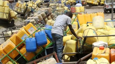 Water Vendors wait for their turn to fetch water at Kitengela on July 21, 2018.
