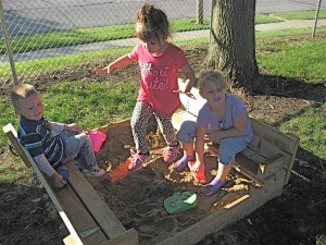PreK students enjoying the sandboxes installed by Matt Wyatt as part of his Eagle Scout project.