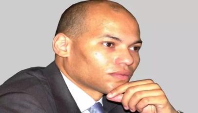 karim wade annonce une plainte contre macky sall