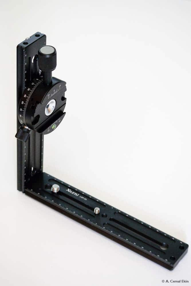 Add the clamp to the vertical bar