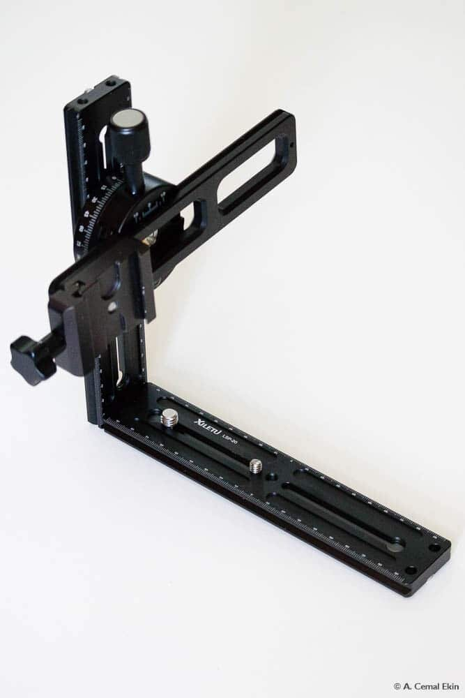 Insert the nodal point slider into the clamp